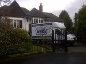 AMS Removals Van in front of a Movers Manchester house
