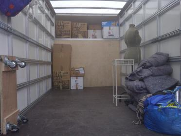 AMS Removals housemovers van getting loaded with items