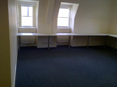 Small empty room with clean carpet